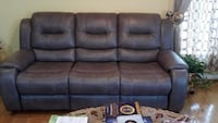 Charcoal Gray two/three seater recliner couches. Woodbridge, 22192