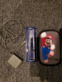 Nintendo DS charger, dock and Mario soft case