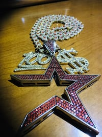 Iced out cosmic star and tennis chain real crystals in the chain.