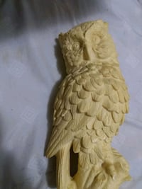 Hand carved owl statue