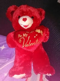 red and white bear plush toy