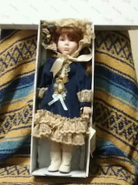 porcelain doll in black and white dress 228 mi