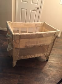 Baby's white travel cot