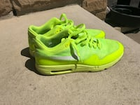 pair of green Nike running shoes Hamilton, L0R 1P0