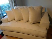 brown fabric sofa with throw pillows 538 mi