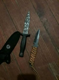 two brown and black handle combat knives Endicott, 13760