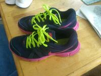 pair of black-and-pink Nike running shoes Lexington, 40509