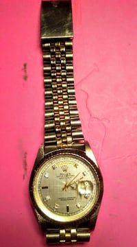 round silver-colored analog watch with link bracelet St. Albert