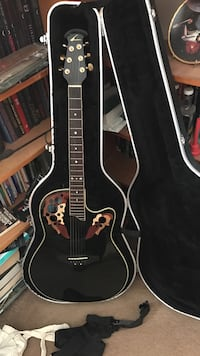 Ovation Americana acoustic/electric with Ovation hard case, plug in tuner, strap, and extra set of strings. Not looking to trade, looking to pay bills. Dayton, 45405