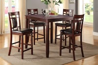 rectangular brown wooden table with four chairs dining set