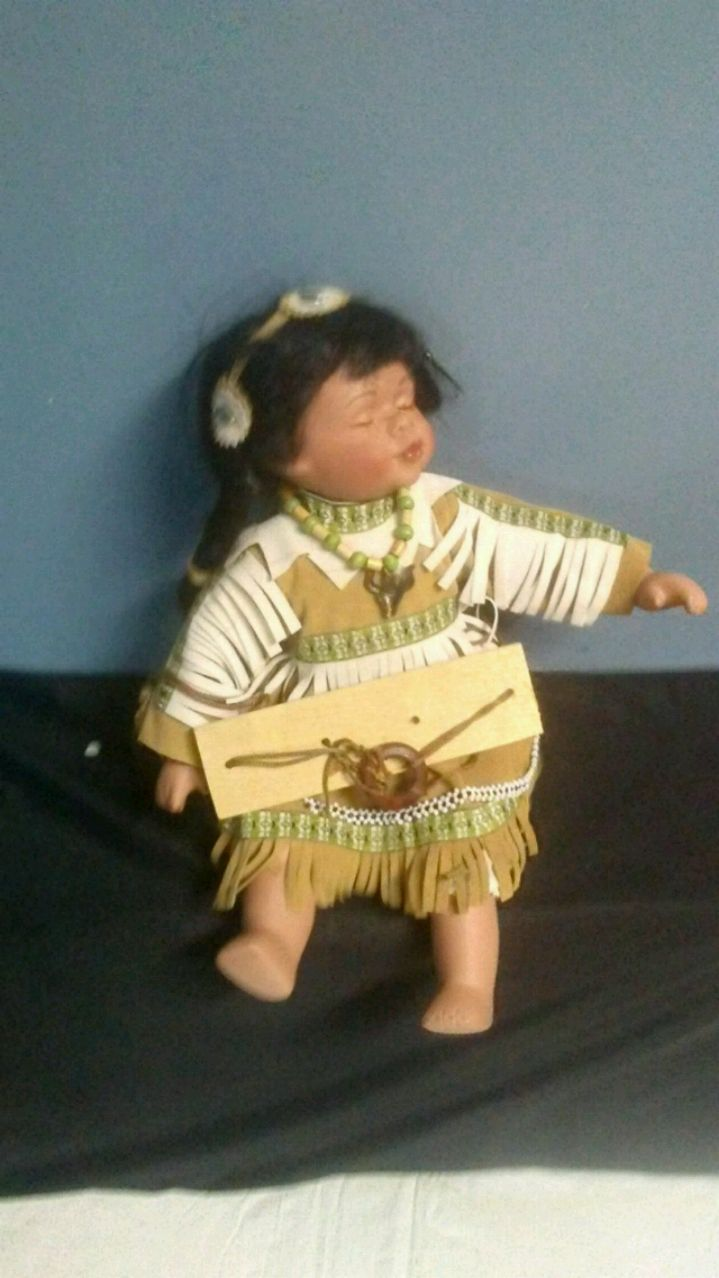 Photo Native American porcelain baby doll