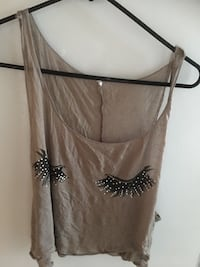 brown and black sleeveless top
