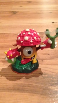 White yellow and maroon mushroom plastic toy Colwood