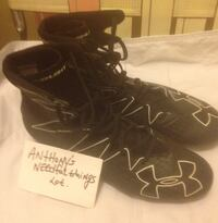 Pair of black Under armour cleats , 10472