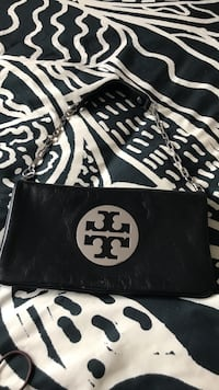 black and gray leather Tory Burch sling bag