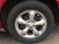 chrome 5-spoke car wheel with tire Norman, 73069