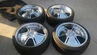 "set of forte 20"" rims with tires"