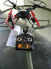 black and red quadcopter drone with remote