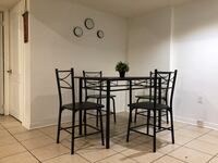 Black metal framed glass top table with chairs set Brampton, L6R 2Z6