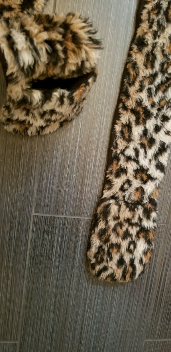 33ba41806f05 1/5. 1/5. Tap to see more pictures. Swipe to see more info. Leopard print  faux fur hat with paws