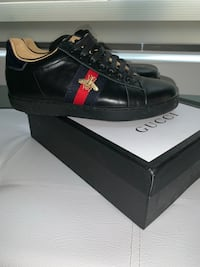 Woman's Gucci Running shoes size 5