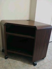 Corner wood TV or entertainment console.