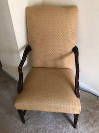 Brown wooden frame padded armchair College Park, 20740