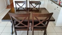 Dining table and Four brown wooden chairs Vancouver, V5W