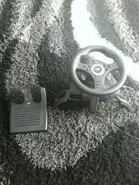 gray and black car steering wheel game controller Winnipeg, R3R 2W9