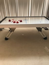 White and black air hockey table Calabasas, 91302