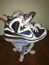 pair of white-and-black Nike basketball shoes Kenosha, 53140