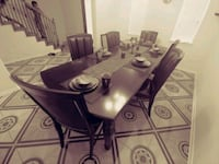 rectangular brown wooden table with six chairs din Houston, 77043