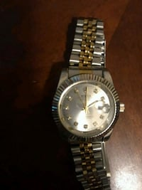round silver-colored Rolex analog watch with link