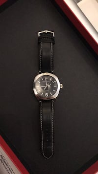 Round black analog Armani watch , have been wearing on occasion Toronto, M3M 2X1