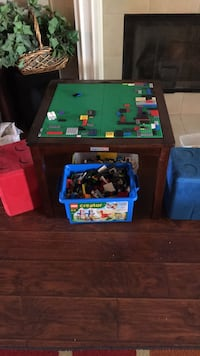LEGO table chairs and legos  chairs open for storage and are half full of legos  Mobile, 36695