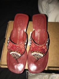 Pair of women's red sandals with box