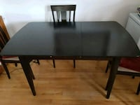 rectangular black wooden table with two chairs Montreal, H2S 2G3