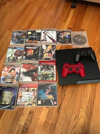 Sony PS3 slim console with two controller and cases