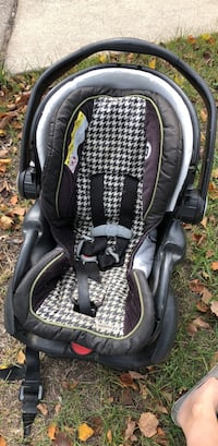 baby's gray and black car seat carrier null