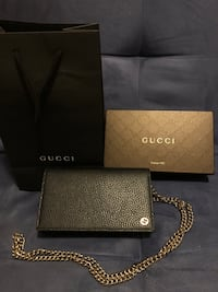gucci leather clutch bag