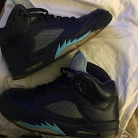 pair of black-and-teal Air Jordan sneakers