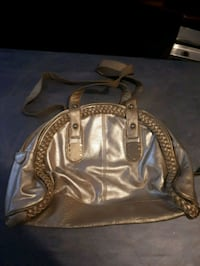 brown and gray leather handbag 2866 km