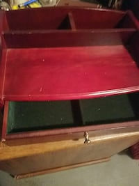 red wooden shelf cabinet