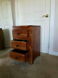 brown wooden nightstand with drawer