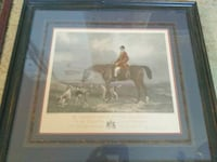 person riding brown horse photo with black wooden frame