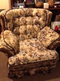 Brown and white floral fabric sofa chair  . Very comfortable , pets and smoke free home,price for fast sale