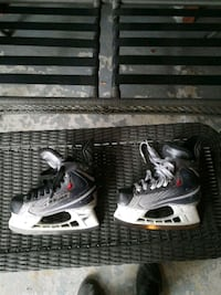 pair of black-and-white youth skates