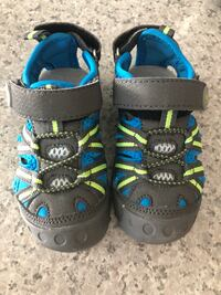 pair of black-and-blue sandals Calgary, T2Z 4C8