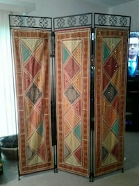 Iron room divider with tapestries