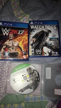three assorted Sony PS4 game cases 1159 mi
